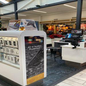zagg kiosk inside of a mall